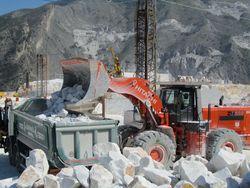 Hitachi ZW550 loading waste marble