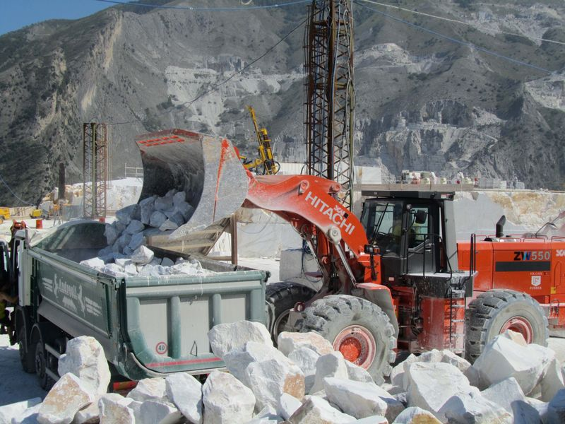 Hitachi ZW550 loading waste marble