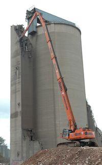 Hitachi 1200 demolishing at 55 feet