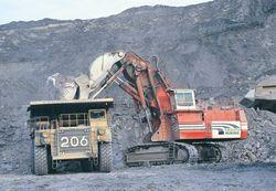 O&K RH200 hydraulic excavator & Cat 789 dump truck