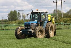 Ford 8340 SLE spraying spring barley