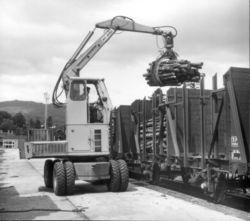 Hymac 610 with a log grab
